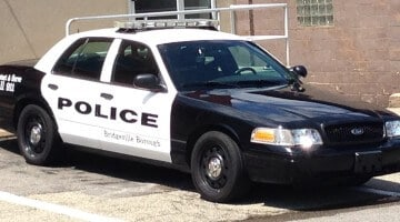 A Bridgeville Police car parked outside of the station