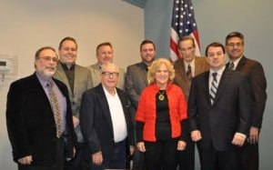 Members of Bridgeville's government stand in a posed photo. Pictured are: Back Row: Bruce Ghelarducci, Jason Sarasnick, William Henderson, Neil Lyons, William Colussy, Mike Tolmer Front Row: Nino Petrocelli Sr., Anne Marie Parisi, Mayor Pasquale DeBlasio