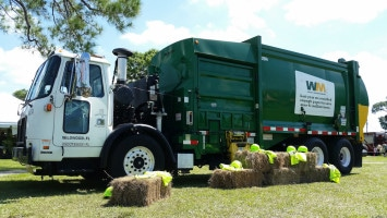 A Waste Management truck parked in a field in Pinellas Park, Florida