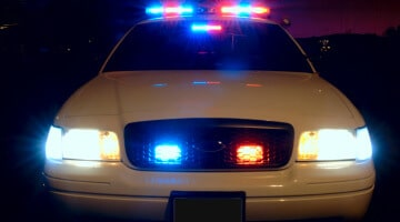 Ford Crown Victoria Police Interceptor with emergency lights activated