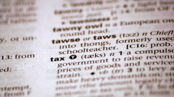 """A photo of the word """"tax"""" in a dictionary"""