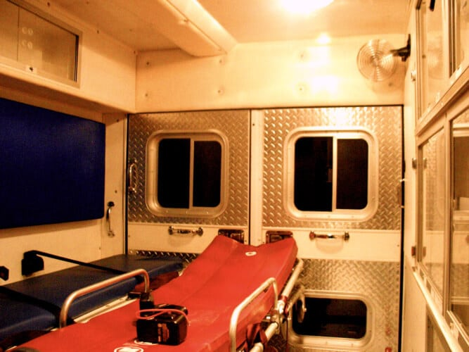 Two metal doors as seen from the inside of the back of an ambulance