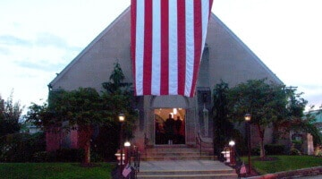 A U.S. flag hangs outside the entrance of Holy Child church.