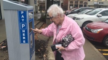 Marjorie Jablonski demonstrates the trouble she was having with a Bridgeville parking kiosk