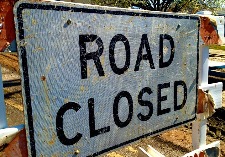 """A """"Road Closed"""" sign at a construction site"""