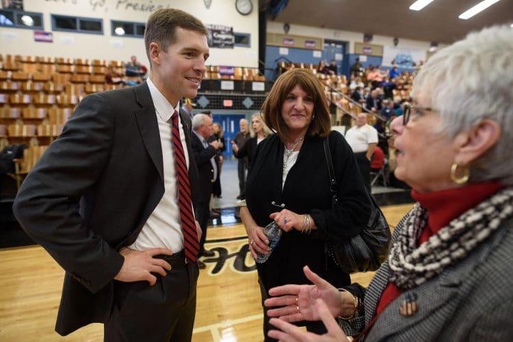 U.S. Congressional candidate Conor Lamb speaks with a voter at a campaign rally