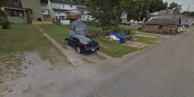 A Google Maps street view of the alley behind Mill Street