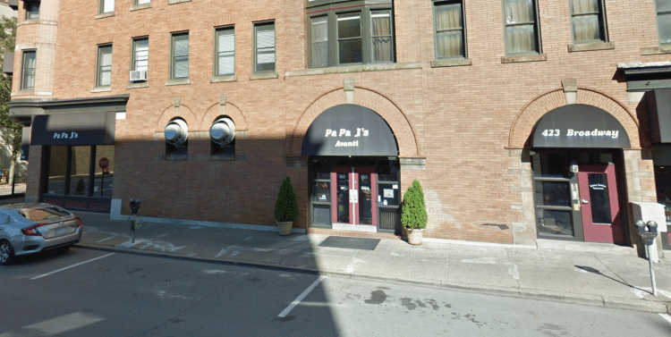 The building that housed Papa J's restaurant and several apartments in Carnegie was severely damaged in a March 2018 fire.