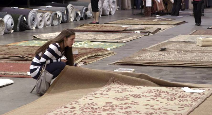 A customer shops at Rusmur Floors Carpet One during the company's warehouse sale.