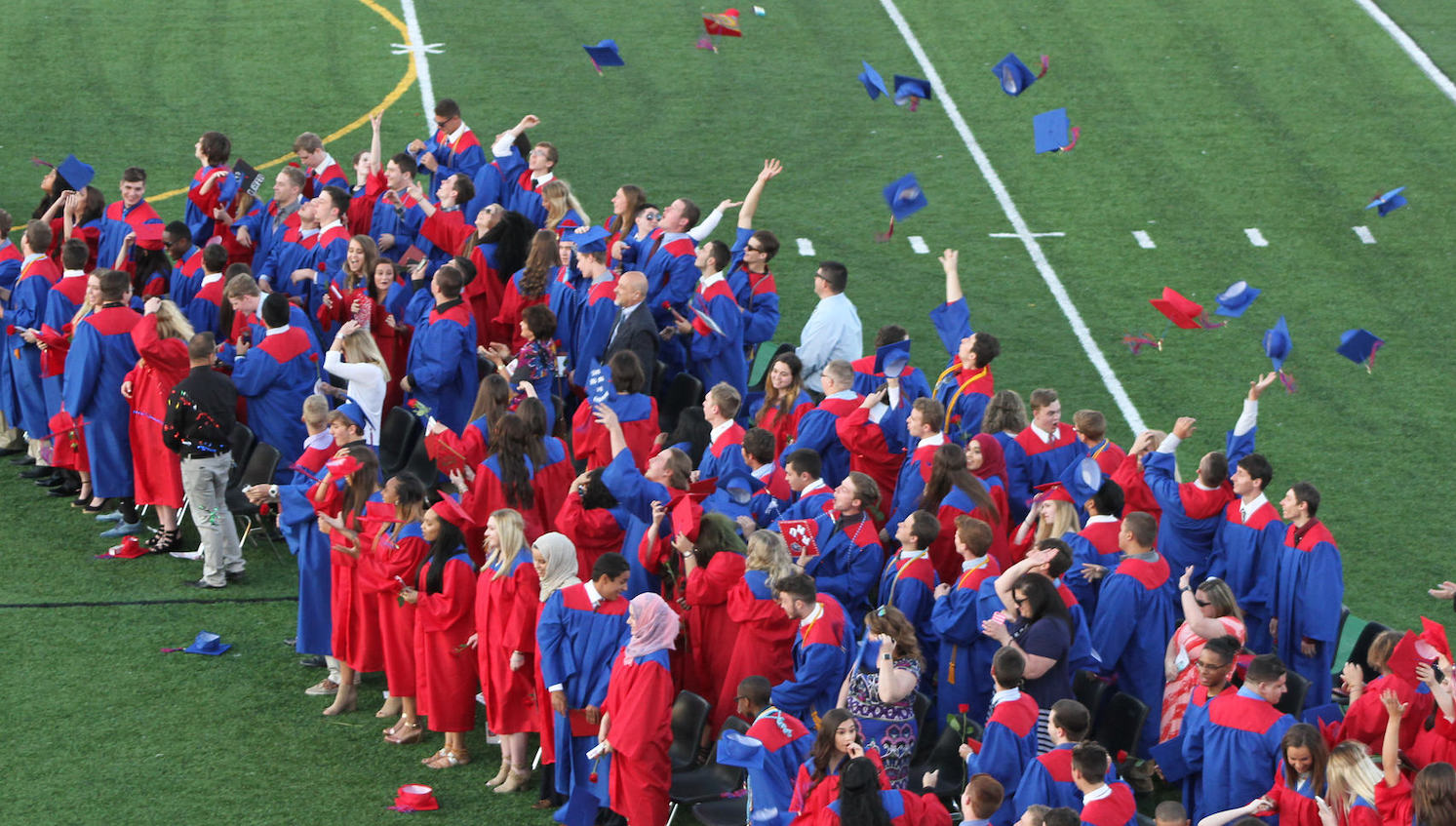 Chartiers Valley Class of 2017 graduates toss their caps in their air at their commencement ceremony.