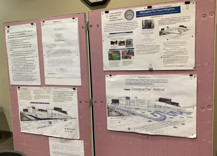 A set of pinboards, each larger than a door, display maps, drawings, and other drawings that Bob Fryer used at Bridgeville's January 2019 council meeting.