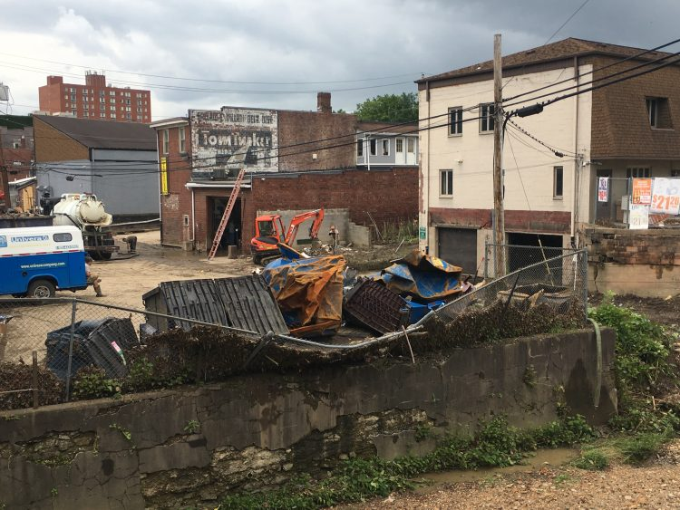 Dumpsters pictured in the aftermath of Bridgeville's June 2018 flood.