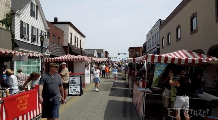 Vendor booths line both sides of Washington Avenue during Bridgeville's Day on the Avenue. Screencap via YouTube's EZCruzer