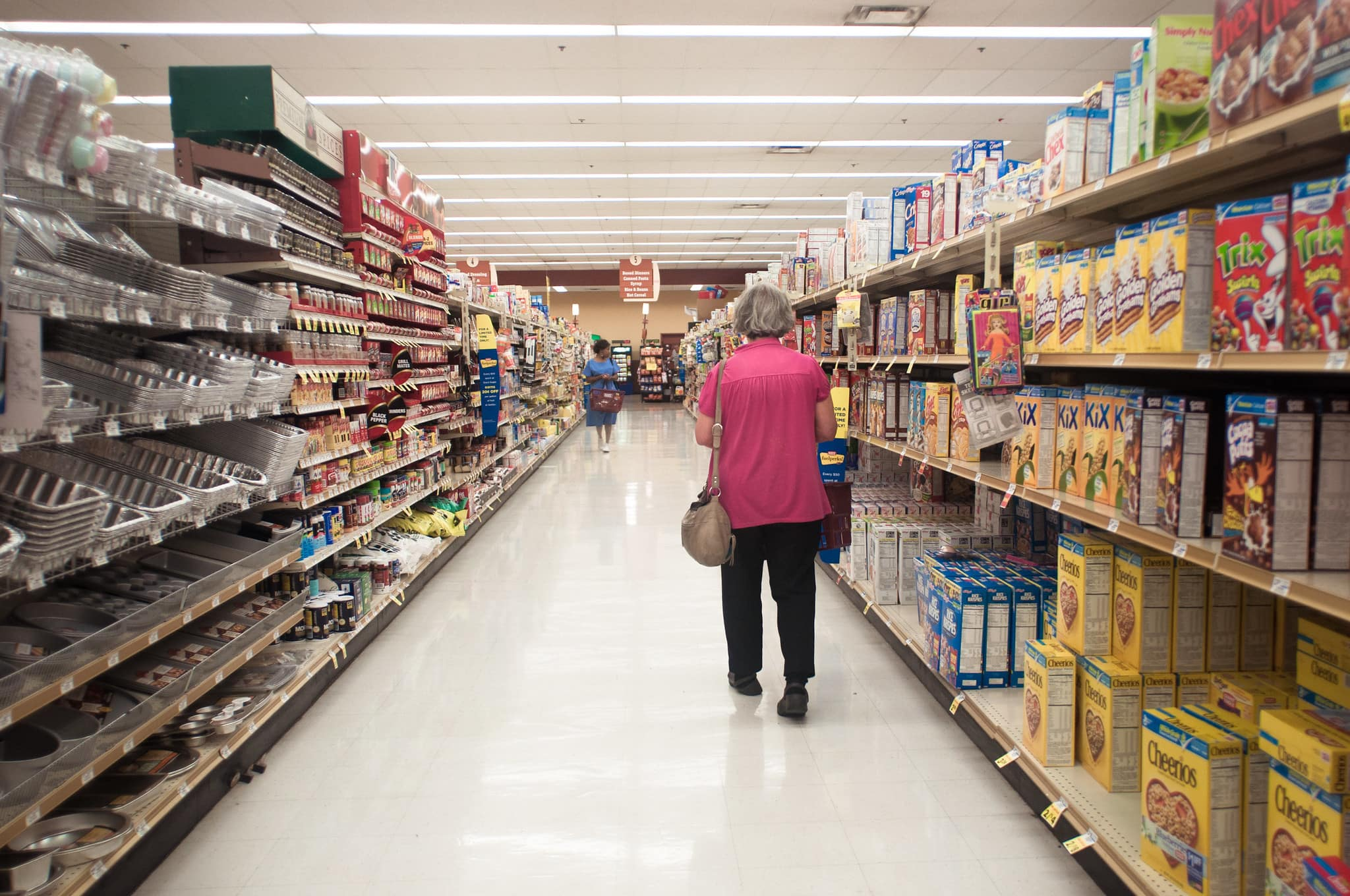A woman walks down an aisle at Giant Eagle