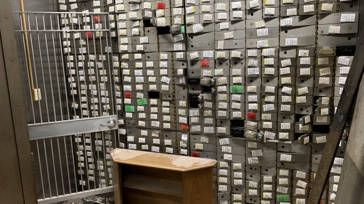 This wall of safety deposit boxes from the 1950s onward came with the building.