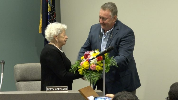 Council president William Henderson presents mayor Betty Copeland with a bouquet of flowers in the night she received the Pennsylvania Mayor of the Year award.